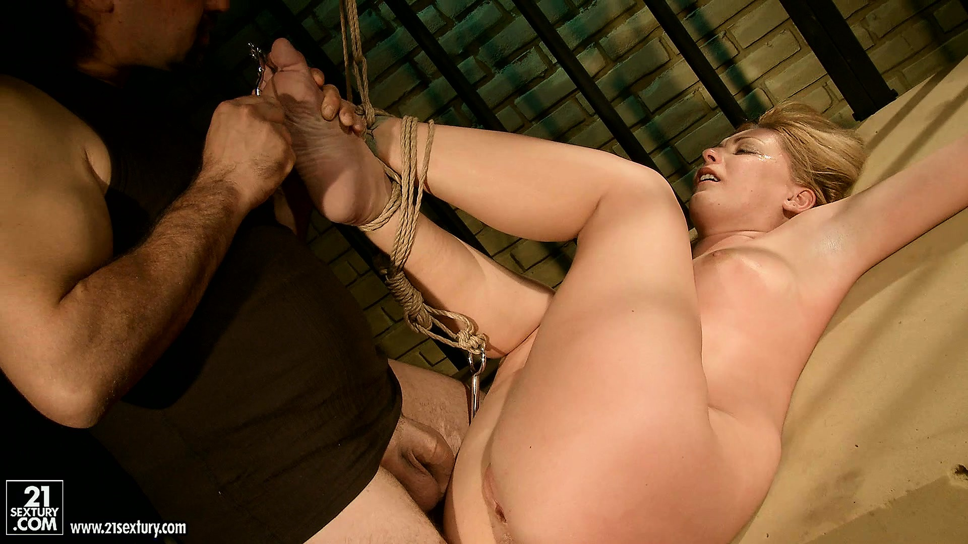 Porn Tube of She's Up Against The Bars And Then Put On The Floor For Some More Torture