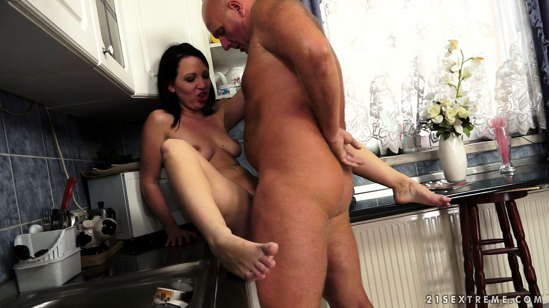Porno Video of Old Dude Has A Young Hottie And They Trade Oral In The Kitchen