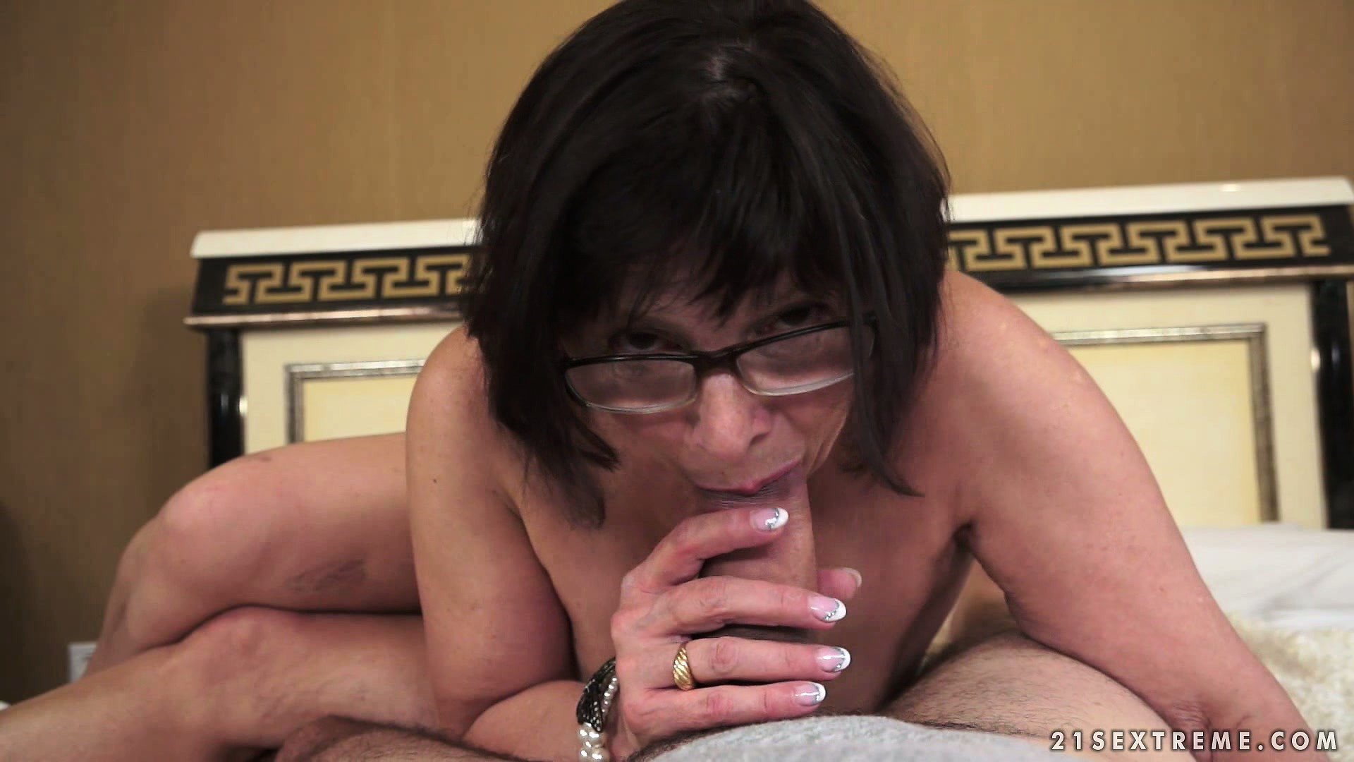 Porno Video of Bbw Granny In Glasses Takes A Ride On Top Of A Hard Meaty Shaft
