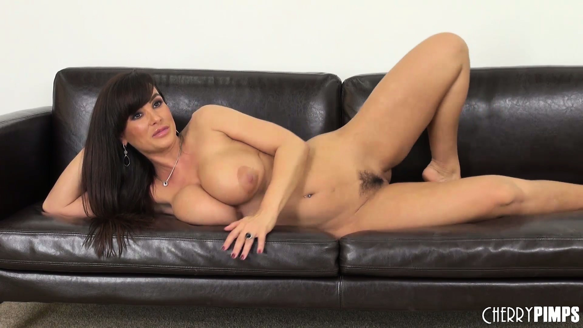 Porno Video of Lisa Ann Gets On The Floor To Toy And Back On The Couch To Pose