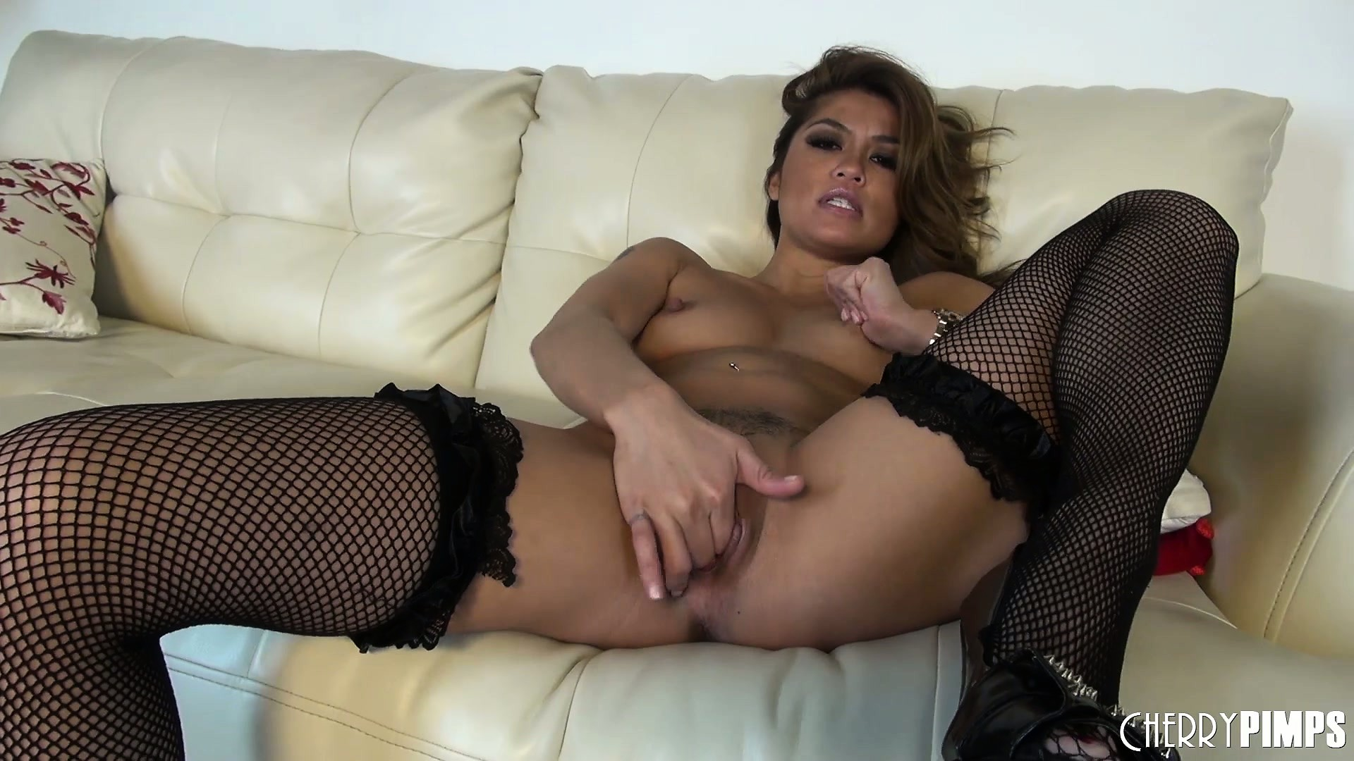 Porno Video of Charmane Star Puts On Black Stockings And Batters Her Sweet Clam