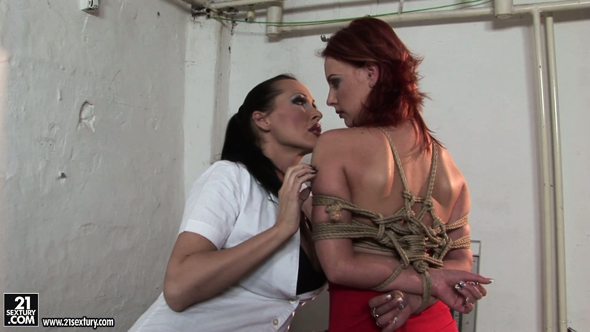 Porno Video of Busty Brunette Doctor Puts A Petite Redheaded Bimbo In Bondage