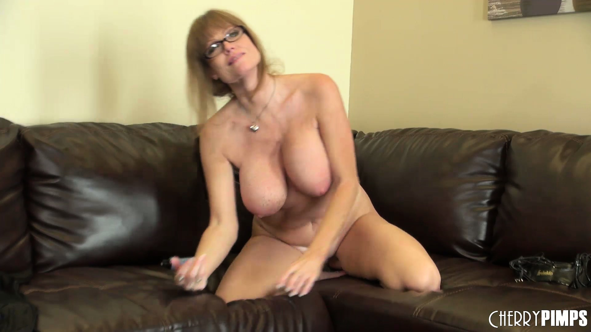 Porno Video of Busty Cougar With A Hot Secretary Look Masturbates On Camera