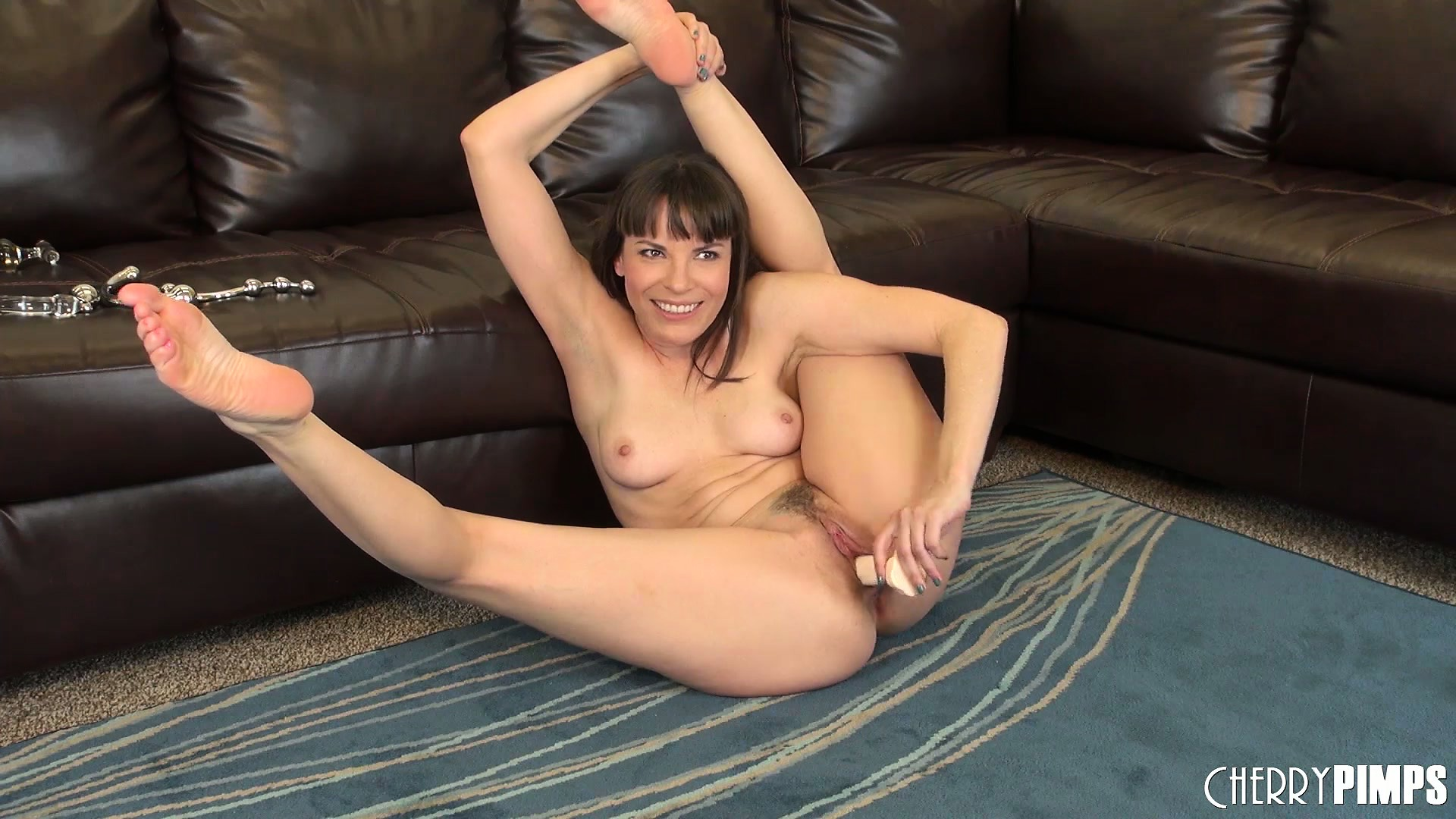 Porno Video of Skanky Playmate Dana Dearmond Rubs Her Tough Muff Until It Leaks Ooze