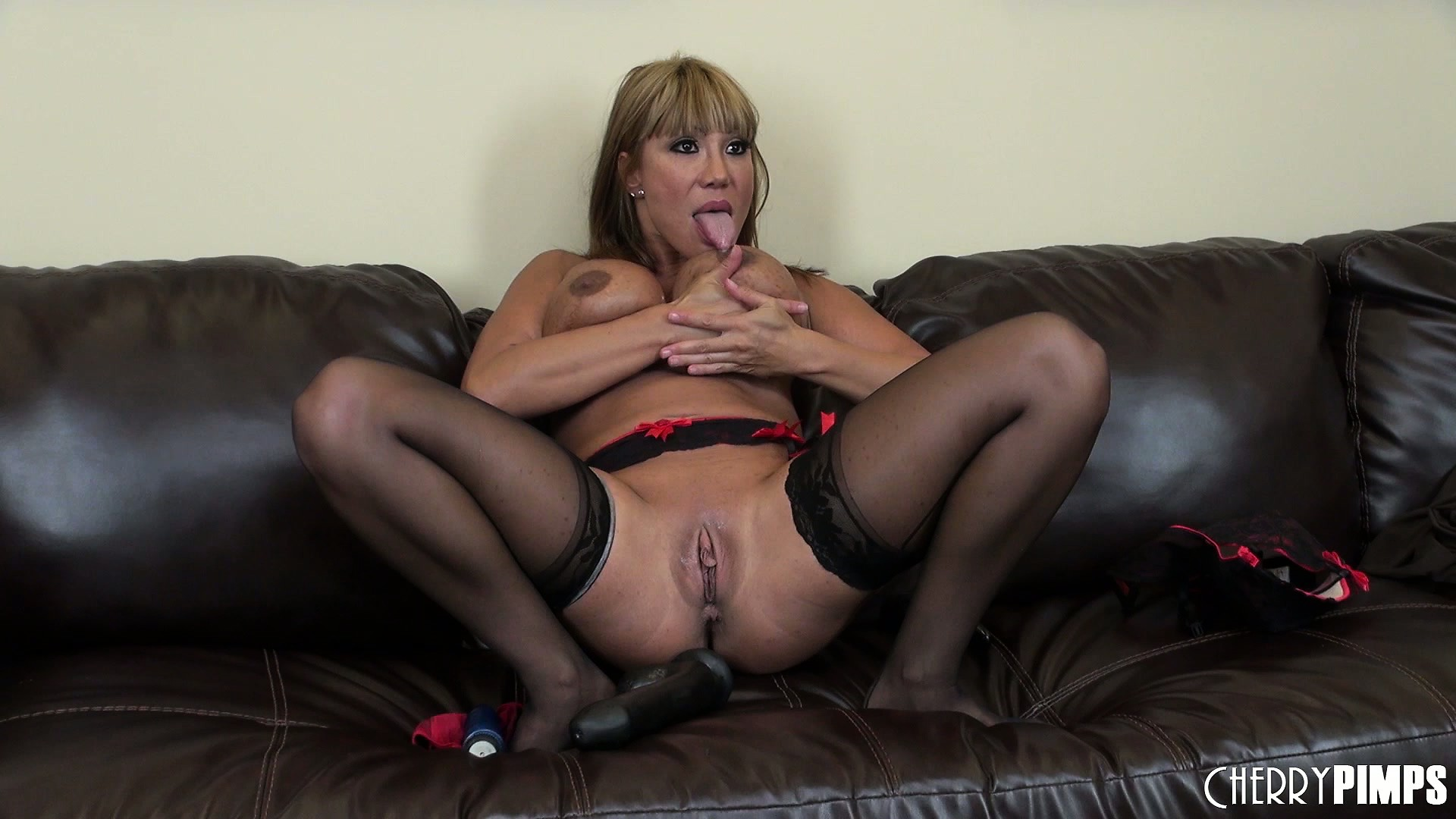 Porno Video of Ava Devine Shoves A Huge Dildo In Her Kinky Ass With Great Ease