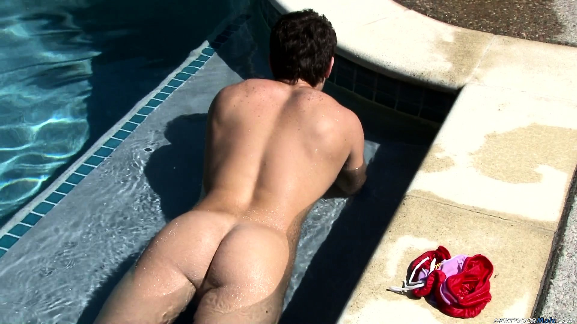 Porno Video of Scotty Stands By The Pool Jerking And Then Lies In It To Show His Ass