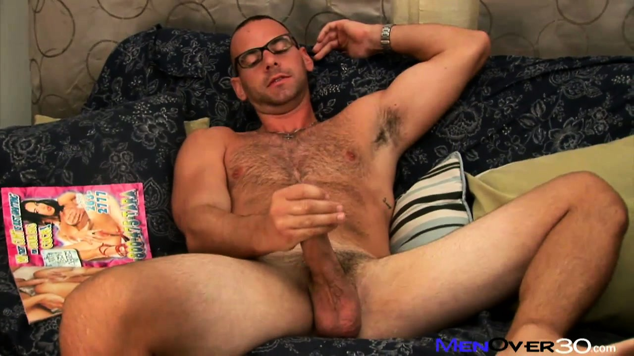 Porno Video of Hot Bear In Glasses Plays With His Cock While Leafing Through A Gay Porn Mag