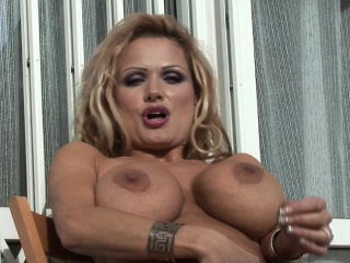 Lusty Blonde Bunny Sharon Sits On The Balcony To Play Snatch With Her Bouncing Boobs And Balding