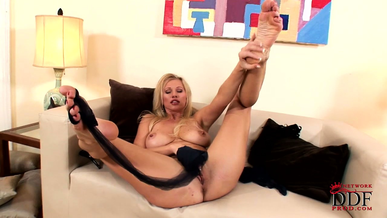 Porno Video of Majestic Blonde Babe Slips Out Of Her Stockings And Uses Them To Masturbate