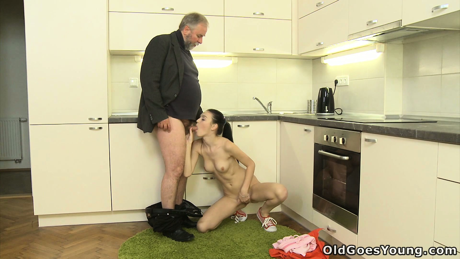 Porno Video of Katia Lets The Old Guy Suck Her Bald Wet Pussy In The Kitchen