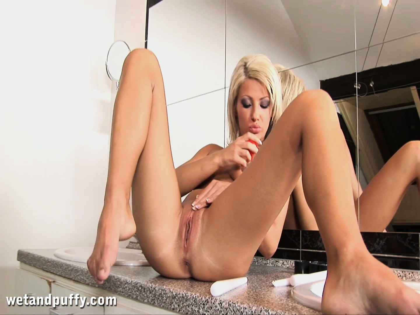 Porno Video of Blonde Slut Rubs Her Pussy Lips And Uses A Suction Cup On Her Clit
