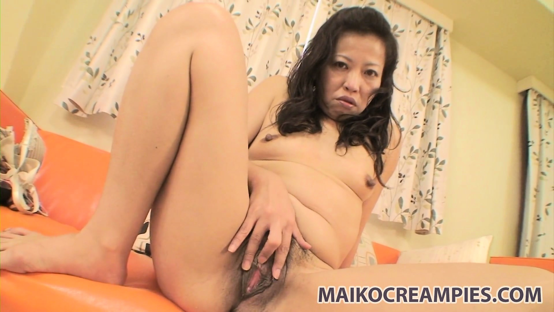 Porno Video of Nasty Asian Wife Plays With Her Furry Slit And Spreads Her Lips Wide Open
