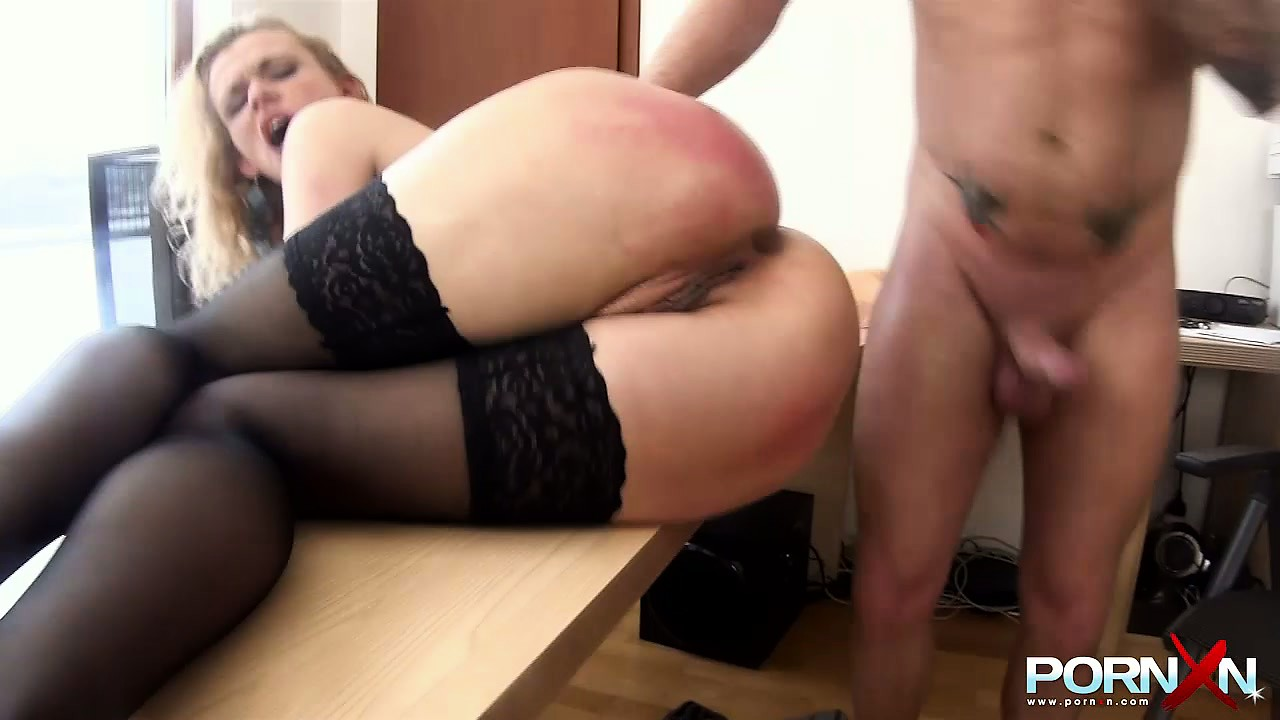 Porno Video of The Sexy Blonde Lies On The Desk As A Dildo Paves The Way For Extreme Penetration