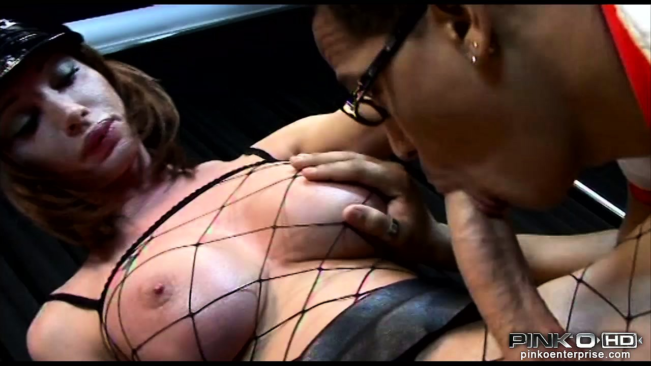 Porno Video of A Dude With Big Fake Tits In A Fishnet Body Stocking Gets His Cock Sucked
