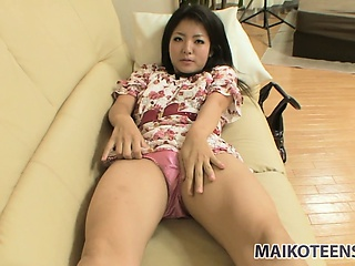 nao, a skinny asian girl with sexy slim legs, lies on the couch, eager to get fucked hard