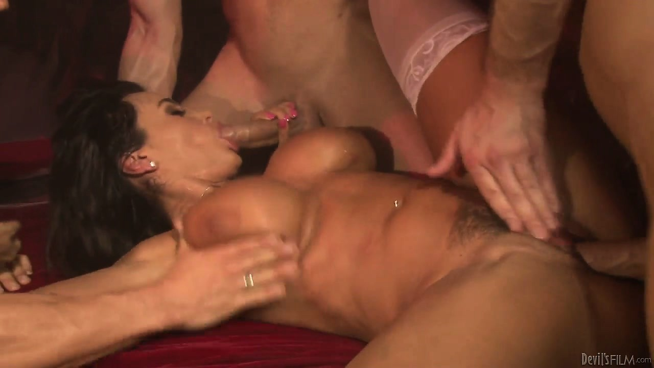 Porno Video of The Devils Many Cocks Invade This Naughty Brunette Bitch In A Gangbang