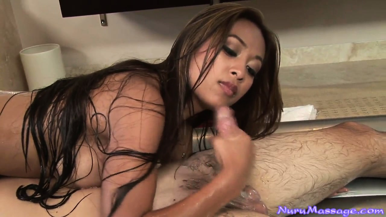 Porno Video of Long-haired Asian Beauty Rubs Down A Man With Lube And Wanks Him