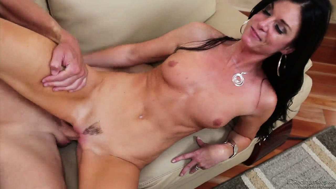 Porno Video of Skinny Cougar Gets Her Clit Rubbed While She Rides On Her Lover