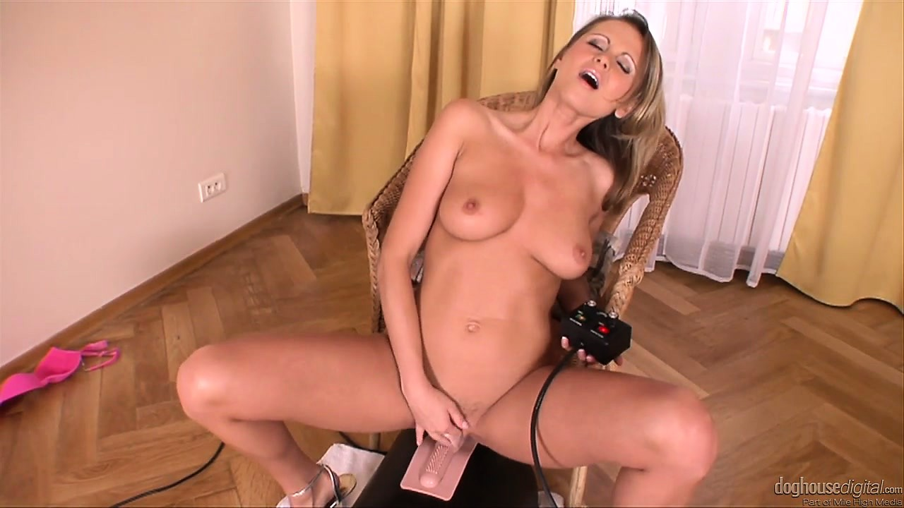 Porno Video of She Sucks The Dildo On The Sybian Machine That's Going To Fuck Her