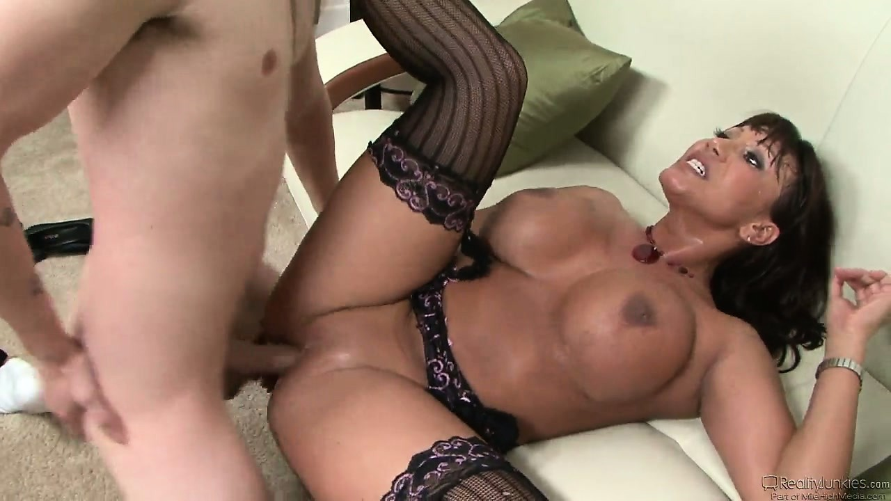 Porn Tube of Brunette Cougar In Sexy Lingerie Bends Over For A Hard Young Cock