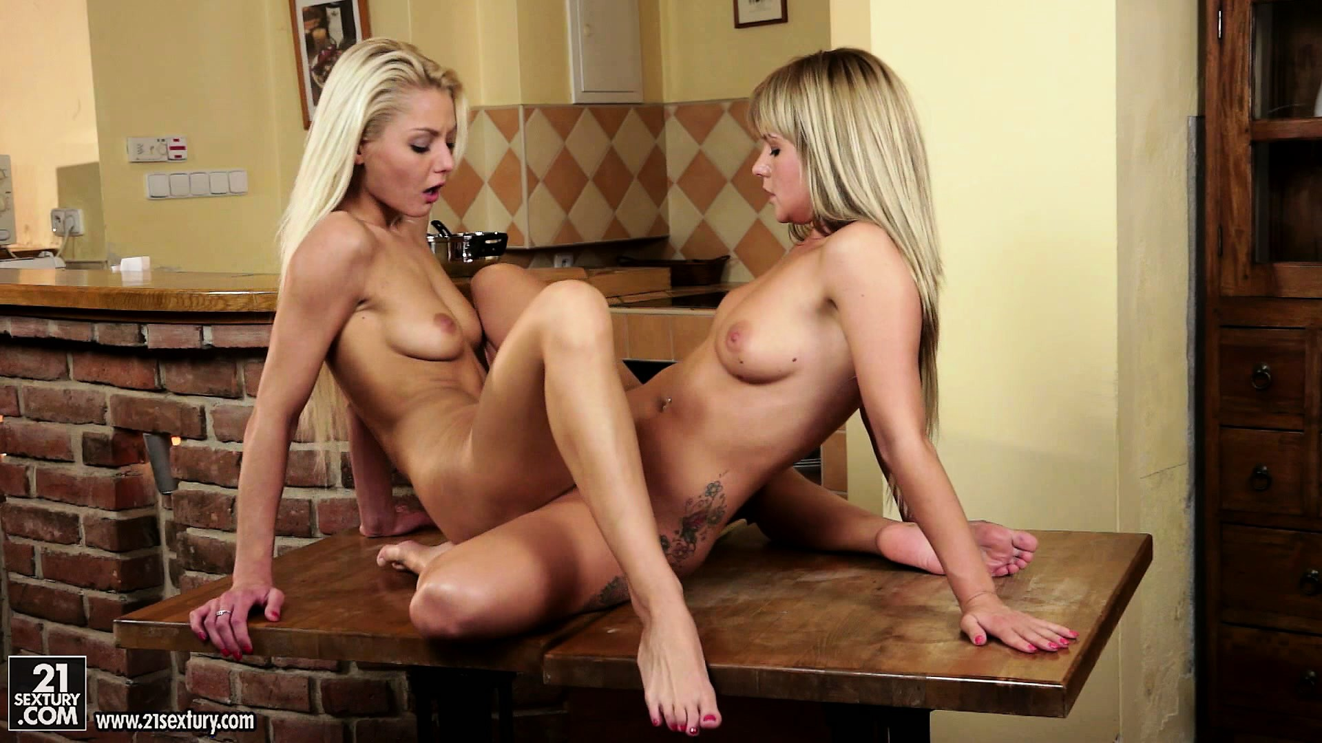 Porno Video of Lesbian Babes Use Their Kitchen Table To Scissor With Each Other